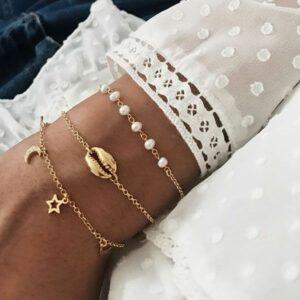pulseras bano oro estrellas, luna, concha y perlas