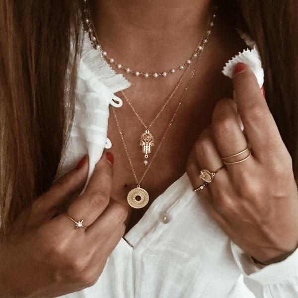 collares perla, hamsa, medalla plata bano oro neska polita