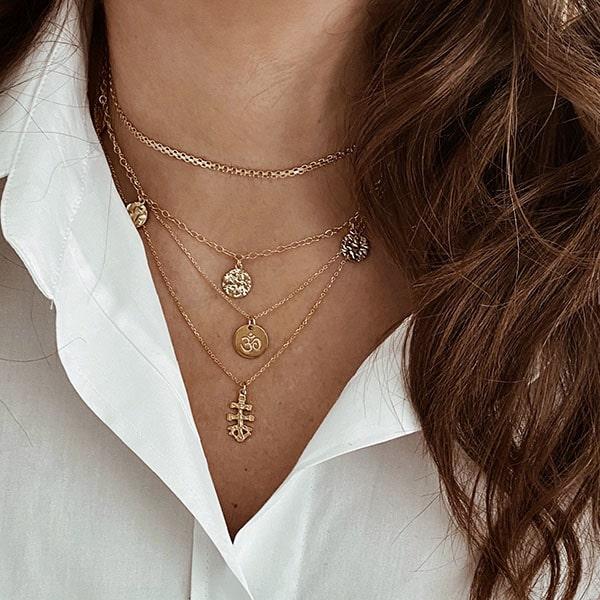 collares simbolo om cruz caravaca